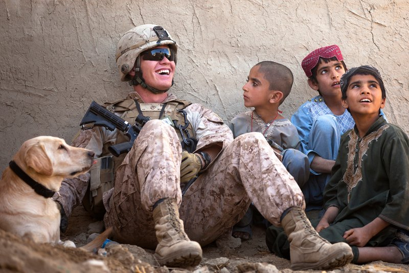 U.S. marine talking to Afghan children (2011).