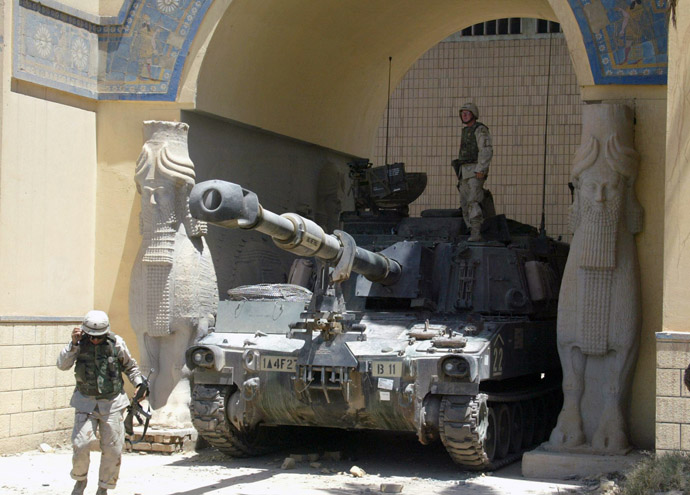 A U.S. tank blocks the entrance to the Iraqi National Museum.